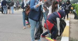 حملة تطويعية جماعية  لتنظيف الساحات الجامعة وحدائقها